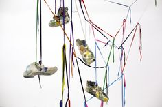 Lorenza Boisi, Urban Ritual, 2016, ceramic and shoe laces, variable dimensions - 7 different exemplars