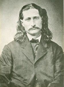 "While playing poker in Deadwood, South Dakota, James Butler ""Wild Bill""  Hickok was murdered. Hickok was holding Aces and Eights and that's how the hand got the nick name of Dead Man's Hand."