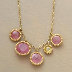 Yellow diamond among rose cut pink sapphires. Love the detail around the stones.