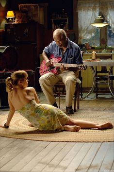 """A scene from the film """"Black Snake Moan"""" starring Samuel l Jackson and Christina Ricci.  Though the guitar playing was dubbed for the audio, Samuel Jackson really  did play the guitar during his scenes in this movie."""