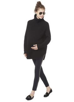 Love everything about this look. The sweater has a great cut and fit and I always love black because it goes with anything. Also like the black flats. Makes a more casual sweater and legging outfit more elevated.