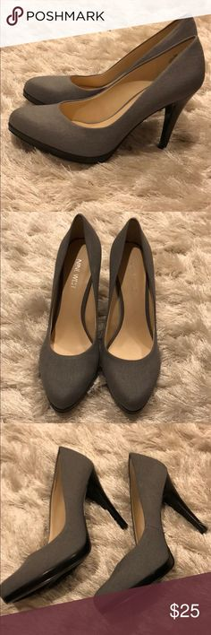 BRAND NEW grey Nine West heels. Super cute grey pumps with black heel and platform from Nine West. I love these, but I have never had a reason to wear them! I did get rid of the box when I put them in my closet, but no scuff marks or anything since they haven't been worn Nine West Shoes Heels
