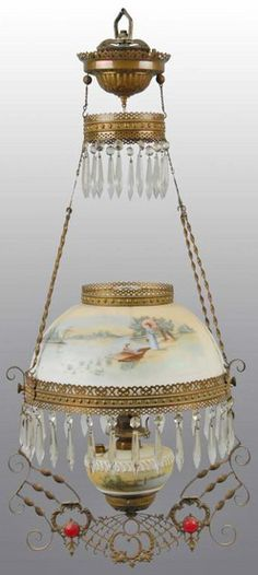 lighting, America, A Victorian kerosene hanging parlor lamp, original decorated milk glass shade includes prisms and features man in boat and lady with parasol. Circa 1876-1925