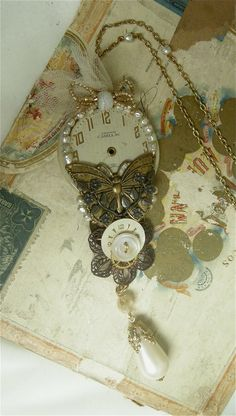 Steampunk pendant - repurposed watch faces, buttons, filigree, assemblage