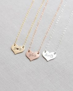 Engraved Heart Disk Necklace by Olive Yew. This dainty small heart disk necklace can be personalized or left blank. Engrave up to three letters/characters and 6 font style choices. Create an adorable sweetheart necklace in silver, gold or rose gold.