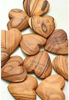 I love this wedding favor! Lovely wood hearts with the couples monogram and wedding date.