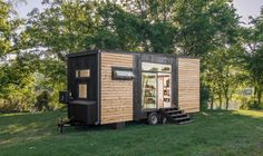 Alpha Tiny House on Wheels by New Frontier Tiny Homes Tiny House Movement // Tiny Living // Tiny House Exterior // Tiny Home Siding // Modern Tiny House, Tiny House Living, Tiny House Design, Tiny House On Wheels, Small House Plans, Tiny Houses For Sale, Tiny House Movement, Alpha Tiny House, Glass Garage Door