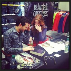 #AldenEhrenreich and #AliceEnglert giggling over seeing Alden's face on an Ethan Wate t-shirt for #BeautifulCreatures for the first time.