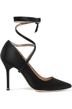 ONLINE EXCLUSIVE AT NET-A-PORTER.COM. Part of the label's hotly anticipated collaboration with Manolo Blahnik, Vetements' pumps have been handmade in Italy from lustrous black satin. This classic point-toe pair has slim ties that wind around your ankle and a smooth leather lining. We think they look especially cool with jeans.