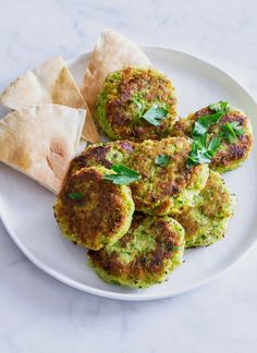 Peas are more than just a healthy side dish! This weeknight dinner take on classic falafel is EASY as can be. A can of chickpeas is your base, and fresh spring peas make it bright and fun! You'll need: chickpeas, peas, red onion, garlic, lemon parsley, cumin, red pepper flakes, and flour.