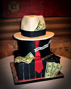 this is the cake i really like but i could not find anyone to make it. i have no pictures of the actual cake i used but its was a suit bottom and a white shirt top with a bow tie. and i got that from walmart also for $52.00