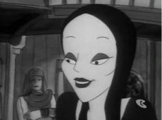Morticia Addams from the Addams family cartoon on Saturday morning Morticia Addams, The New Yorker, Addams Family Cartoon, Long Straight Black Hair, Black Gothic Dress, Charles Addams, Wednesday Addams, Pale Skin, Monsters