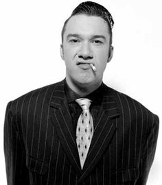 """Mark Lamarr is an English comedian, poet, radio DJ and television presenter.  """"Hello welcome to the show, I'm Mark Lamarr, The one eared man in the valley of the deaf."""" - introduction to his radio show"""