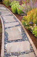 Stepping stone rock path in drought tolerant California garden