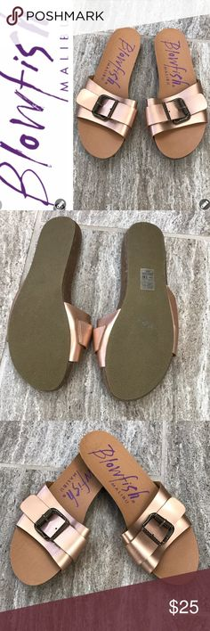 "NWOT ⚡️Never Worn⚡️ Blowfish Copper Slides NEVER WORN NWOT Blowfish Copper slides are perfect for your summer wardrobe! These man made flats feature an adjustable decorative buckle style across the upper for comfort and support. Trendy copper hue. Rubber Sole. Approx 1/2"" Heel   Very versatile and comfortable. Smoke Free home. Blowfish Shoes Flats & Loafers"