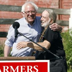 Musician Willie Nelson, right, appears at a rally in support of Rep. Bernie Sanders, I-Vt., at a farm in Charlotte, Vt., Tuesday, Aug. 8, 2006.
