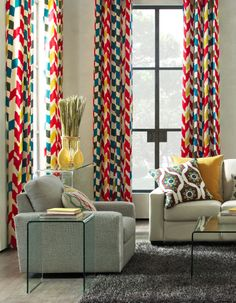 Add color to your apartment or home without having to paint the walls!  Use pillows, window panels, and rugs with big pops of color.