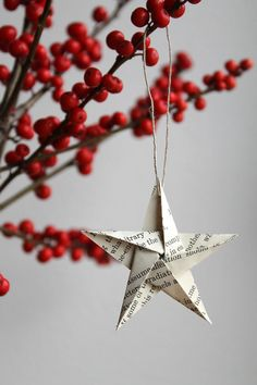 Adore.  Origami star Christmas ornament set: (made of vintage book pages).  Remodelista