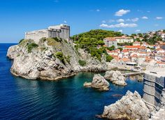 Fort Lovrijenac Dubrovnik, Croatia sky water outdoor Sea Coast promontory headland terrain coastal and oceanic landforms cape cliff tourism rock bay City klippe cove Ocean tree Village Island