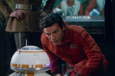 BB-8 and Oscar Isaac as Poe Dameron in Star Wars: The Force Awakens (2015)