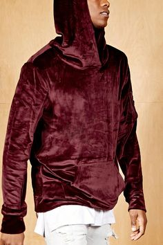 A velvet hoodie by Project X Paris™ featuring a utility pocket on one of the long sleeves, droped shoulders, a kangaroo pocket, and thumbholes.