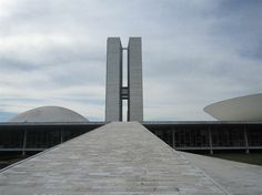 Congreso Nacional do Brasil (The National Congress of Brazil) Architect: Oscar Niemeyer Constructed: 1957 - 1964  Congresso Nacional do Brazil is composed of several buildings, characterized by the sleek twin towers (the Parliament office towers), the domed Senate building and bowl-shaped Champer of the Deputies. Congresso Nacional del Brasil by Oscar Niemeyer, photo: Sara Schjødt Tørnsø.