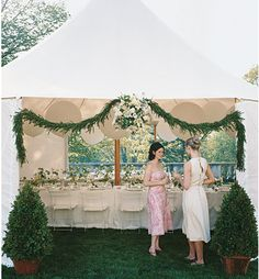 Notice the nice details that dress up this tent.  The potted tree's, the garland and the paper lanterns.