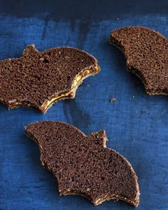 Spooky cookie cutters transform savory sandwiches into Halloween treats. Pumpernickel bread = perfect for bats and witches' hats.
