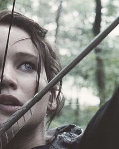 Uhhh Katniss sweetie if you shoot the bow like that your gonna break your nose