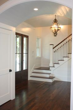 hardwood floors and stairs - love that the stairwell is off to the side so the first thing you see when walk in the house is the foyer, NOT a dark, closed off stairwell