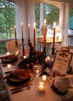 Candlelight Halloween Table Setting  with a Witches Hat Centerpiece