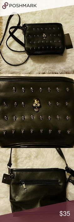 NWT Skull studded small cross body bag New with tags. Faux leather. Super cute! The main skull in the center has jewel eyes. Reminds me of something by Alexander McQueen (NOT by Alexander McQueen). Alexander McQueen Bags Crossbody Bags