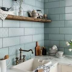 Gray / duck egg blue textured tile backsplash with rustic wood shelf kitchen sink area....Anne Young (@romanvalleyfarm) on Instagram