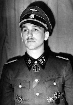 SS-Obersturmbannführer Kurt Meyer, commanding Leibstandarte's reconnaissance…