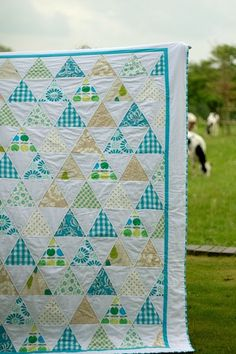 Blue and beige quilt. What about nuetrals quilt as a gift? White background, beige border?