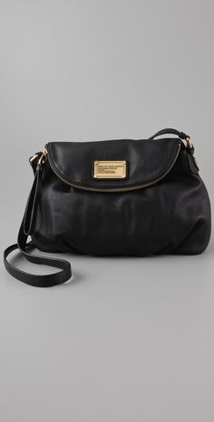 Marc Jacobs Classic Q Natasha bag. Cute & functional. The perfect cross body travel bag. I love that it has a hidden zipper compartment where you can keep your wallet and passport safe!
