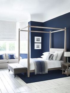 Wardley four-poster bed in oak. Simple and elegant #ShakerStyle #NeptuneHome