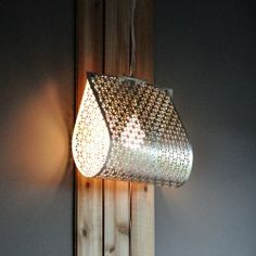 A metal sheet from the hardware store becomes a unique hanging light.