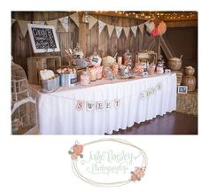Wouldn't have a candy bar, but like the decoration for this display table, with the hay bales and the bunting