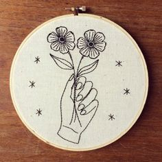 Hey, I found this really awesome Etsy listing at https://www.etsy.com/listing/261904279/hand-holding-flowers-embroidery-hoop-art