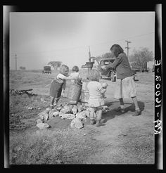 Water supply. Migratory camp for cotton pickers. San Joaquin Valley, California. American River camp Photographer Dorothea Lange Created November 1936