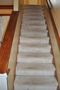 My staircase in our home was in BAD shape! We were students at the time and I was looking for a way to make it look better without breaking the bank! The first thing I did was pull back a corner of. Carpet Treads, Carpet Stairs, Staircase Remodel, Staircase Makeover, Wooden Stairs, Painted Stairs, Home Upgrades, Home Repairs, Diy Home Improvement