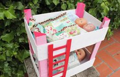 Bunk bed for dolls with strawberry's boxes.
