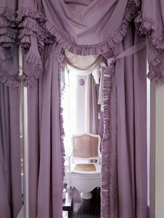 The lavish — and unlikely — combination of a bathroom and silk taffeta in Victoria Press's London home. Read more: Victoria Press's Blithe Spirit