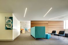A plywood feature wall could be a DIY project. Adds warmth and wood without all the cost. MKDC | Worley Parsons Office