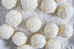 White Chocolate Lemon Truffles.   How good would these be with lime instead...rolled in coconut!