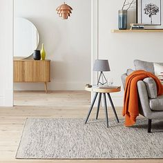 Add warmth and texture to your room with our 100% wool Portofino grey rug. The clean and minimalist design is a versatile addition to any living space.
