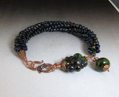 Beaded kumihimo bracelet with lampwork E by thequiltedbead on Etsy, $65.00