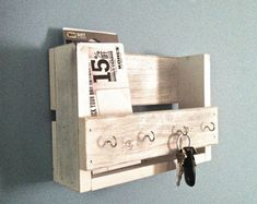 This amazing rustic wooden key holder and mail organizer is made from reclaimed wood (mostly pine) that I have painted and distressed. This will look great in your entryway, mudroom or kitchen. It mea Wood Wine Holder, Wooden Key Holder, Diy Key Holder, Pot Holders, Entryway Shelf, Entryway Decor, Wood Projects, Woodworking Projects, Rustic Wine Racks