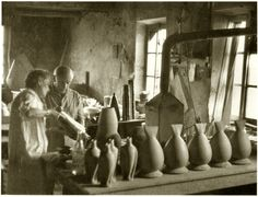 Suzanne Ramié and Pablo Picasso discussing ceramics in the Madoura workshop, 1956